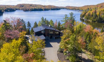 Photo for Luxury waterfront chalet nearby Morin Heights