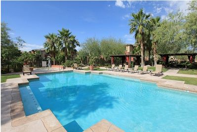2 beautiful heated pools. Your patio looks out to one of the pools.