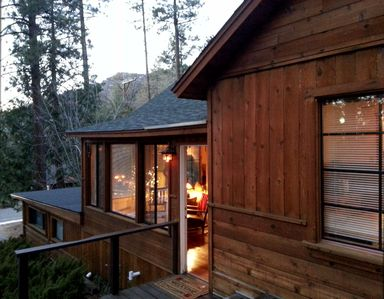 The front door to the cabin. The sun porch creates a cheerful entrance.