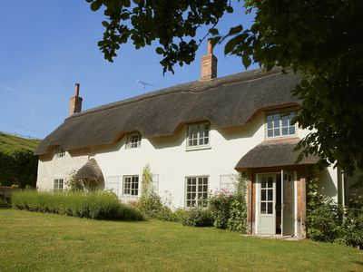Photo for A charming detached thatched period cottage set in the beautiful Wylye Valley.