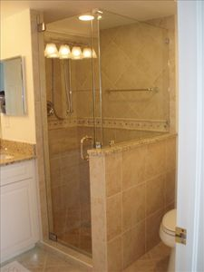 Masterbath shower with new tile shower with spa-like amenities,