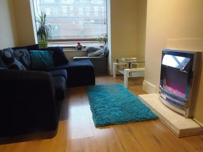 Photo for Light and airy 1 bed flat with large basement kitchen and private outside area