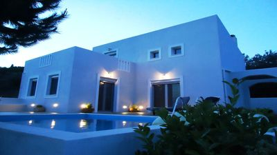 Photo for Super modern  villa & pool in quiet location with stunning views out to sea