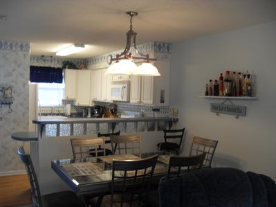 The view of the dining and kitchen area from the living room. Nice open layout.