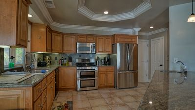 Large open kitchen fully stocked for all of your cooking needs.