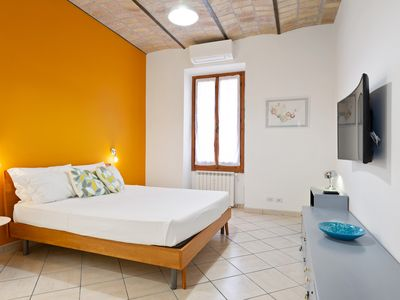 Photo for Colourful flat 15 min from the Colosseum