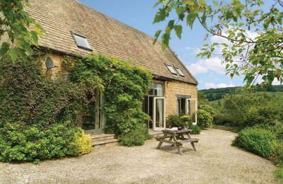 Photo for Buckland Wood Barn is a detached Cotswold stone holiday home, situated at the end of a long drive.