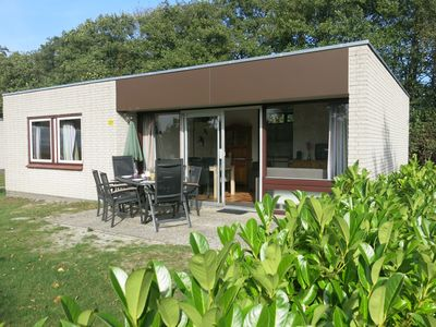 Photo for Detached bungalow, sunny terrace, forest and beach near