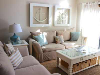 Soft tans with blue and white accents create bright and beautifully retreat.