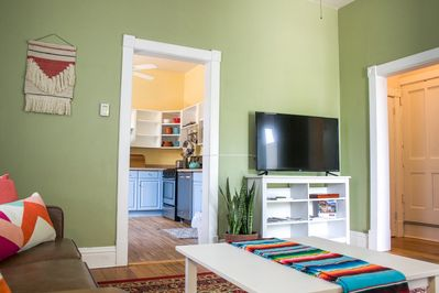"""Bright and cheery living room with leather sofas and 42"""" tv"""