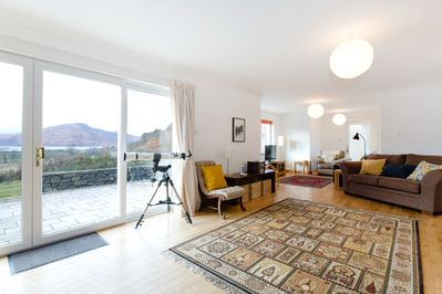 Living room with patio and view to Skye