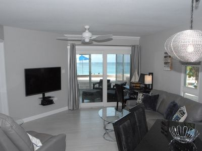 Photo for Renos Completed  For This  Ocean Front On Seven Mile Beach Cayman Reef Resort#32