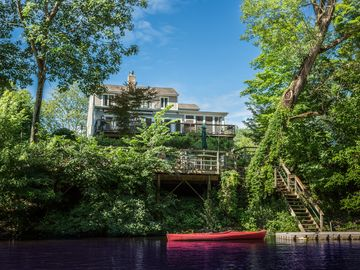 The house is right on the river with private dock, canoe and 2 kayaks