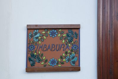 Handcrafted ceramic plaque by Ecuadorian artist, and personalized with apt. name