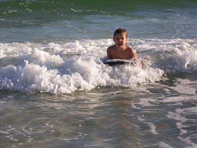 Having fun at the beach....great waves for boogie boarding!!
