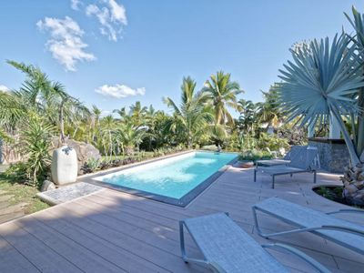 Photo for Bungalow villa with heated pool in tropical garden in St-Gilles les Bains