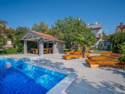 Photo for This 4-bedroom villa for up to 10 guests is located in Crikvenica and has a private swimming pool, a