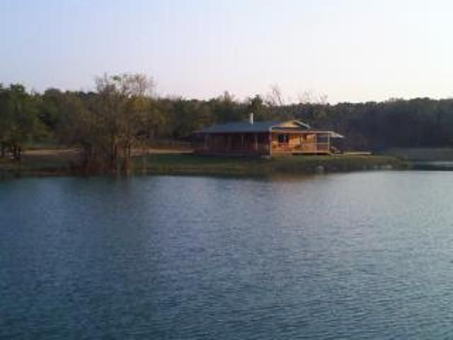 Your own private lakefront log cabin on a 970 acre ranch.