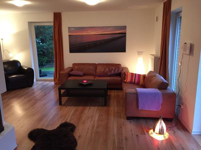 Photo for Bright, modern 4-star ground floor apartment with fireplace, garden and sun terrace
