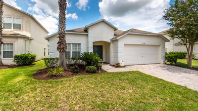 Photo for Family-friendly pool home with games room - lake view - safe and gated community