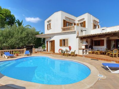 Photo for 5 bedroom Villa, sleeps 10 with Pool, Air Con and Walk to Beach & Shops