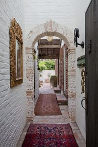 Entry through the arched, historic breeze way