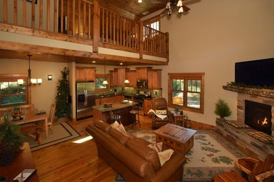 Spacious great room with 18' vaulted wood ceiling