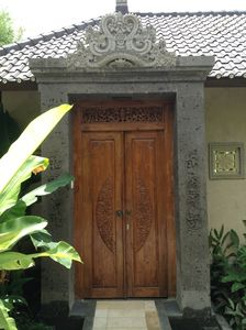The hand carved stone/wooden entrance to Villa Laba Puseh.