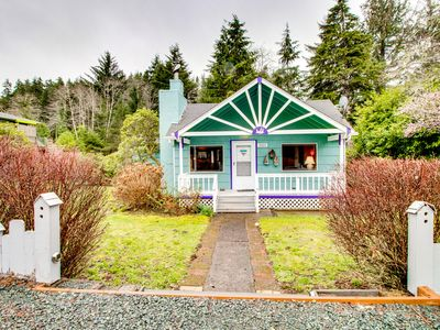 Photo for Charming, dog-friendly home w/ private hot tub, deck & bikes - walk to the beach