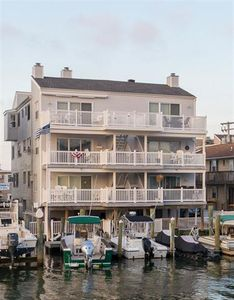 Photo for Beautiful Bayfront condo townhouse with Southern exposure at the far end of 43rd Place
