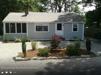 Front yard is beautifully landscaped, neat stone driveway offers ample parking