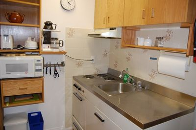 Prepare snacks and small meals in the kitchenette.
