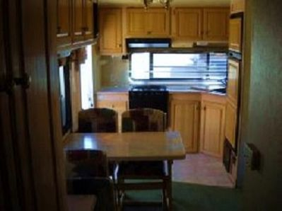 kitchen and dining area of the Golden Falcon 27 ft. RV.