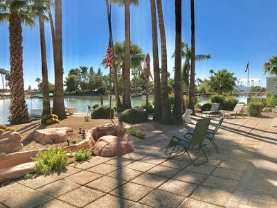 Photo for Newly remodeled lakefront home: pontoon boat, golf cart, palm trees, orchard