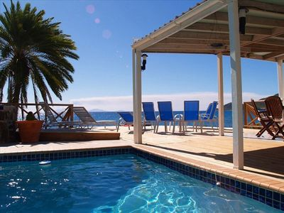 Shell Villa's pool and 'infinity' deck with BBQ are feet from the ocean