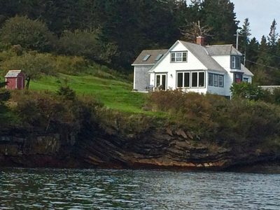 The house is beside the water and a private beach shared by cove residents