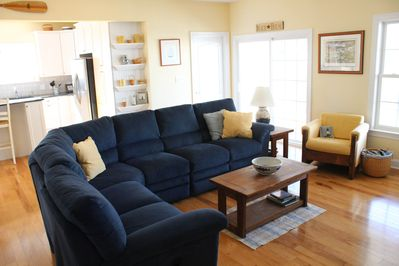 Open concept main level with sectional and ample seating in great room