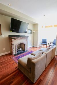 Huge smart tv over a gas fireplace is ideal for unwinding in the afternoons