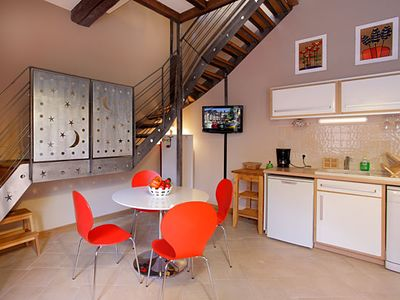 Photo for Triplex in a character house just steps from the Vieux Bassin and salt granaries