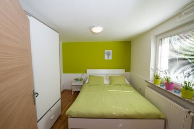 From the living room you enter to green bedroom with queen bed 160 x 200 cm.