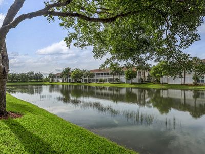 Photo for NEW LISTING! Beautiful lakefront condo w/shared pools, hot tub, and great views!