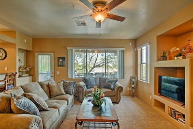 Unwind in this living area with sofas, a gas fireplace & a flat-screen Smart TV.