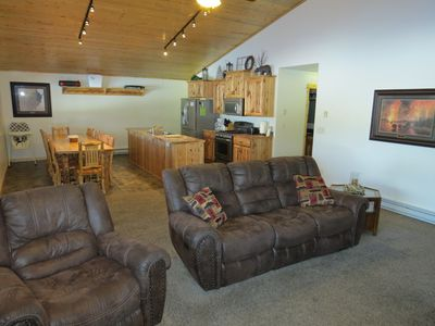 """The comfy leather furniture will help you get into """"vacation de-stress mode."""""""