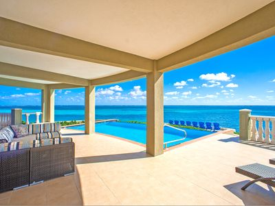 Photo for Cayman Castle: Luxury Gated Estate with Elevated Views, Infinity Pool and Large Private Beach