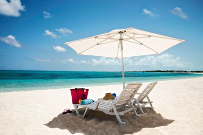 Our Beach set up on the power dry white sand of Grace Bay Beach - Turtle Ridge