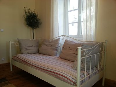 Day sitting area doubles as a single bed.