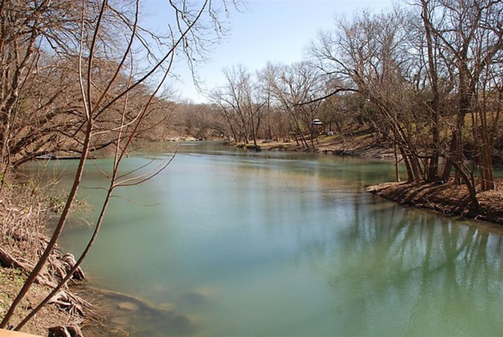 Cozy cabin riverfront fishing tubing rafting hiking for Floating the guadalupe river cabins
