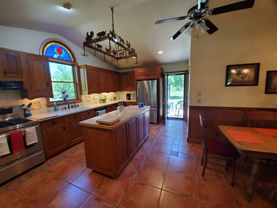 Wide angle view of the kitchen, looking toward the door to the back porch.