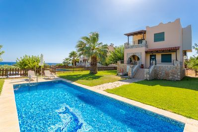 Beautiful villa with private pool, terrace, and lawn with sea views