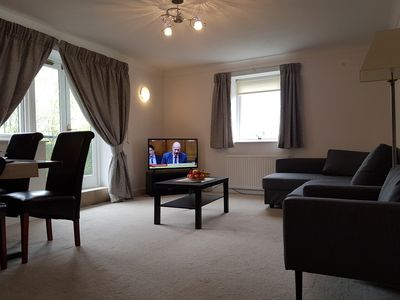 The living room has a dining area and king size sofa bed